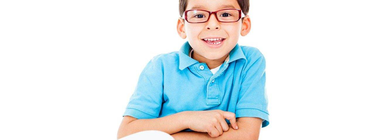 boy with glasses reading - eye doctor - eye exam - Irvine & Laguna Beach, CA